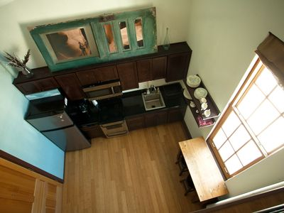 looking down the the kitchen from the mezzanine/ 2nd level