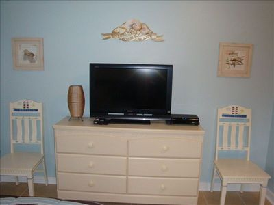 32 inch LCD with Digital HD Cable and DVD player in bedroom.