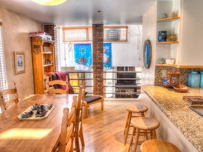 Park City condo rental - Dining area w kitchen to right open to Living Room below.