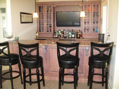 Bar with ice maker, sink and wine cooler