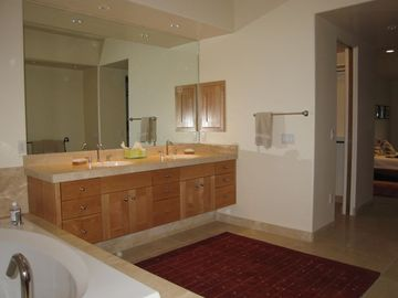 Two master dressing and bathroom suites