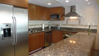 Granite and Stainless in fully equipped kitchen