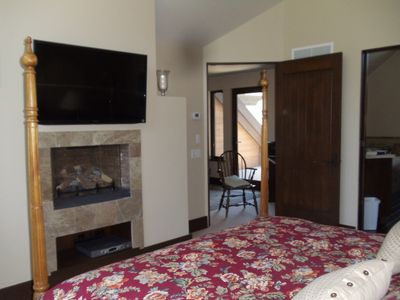 Large master suite (3rd floor) - gas fire place and flat screen TV.