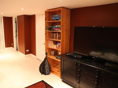 basement living space with games, DVDs, PS3 and flat screen TV