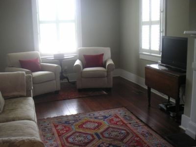 Comfortable Living room with heart pine floors, plantation shutters, HDTV