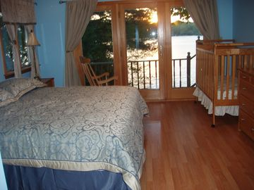 Master bedroom with private balcony/deck and water views