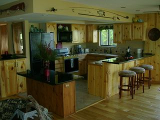 Walker cabin photo - Kitchen area, island and bar.
