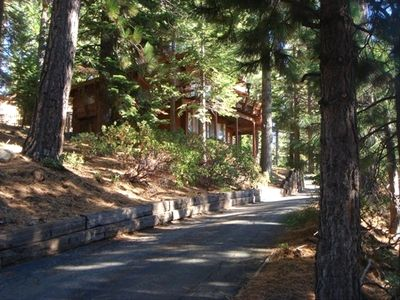private driveway  up to cozy cabin nestled on large lot with great lake views