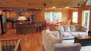 La Follette cabin photo - Open Floor Plan with 20-person dining room table and 7 person island