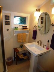 Healdsburg cottage photo - New bathroom off master bedroom is beautifully decorated.