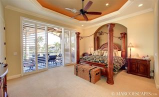 Vacation Homes in Marco Island house photo - Geranium's Master Suite with Direct Access to Pool