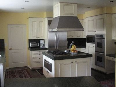 Kitchen with 2 Stoves, Warmer, 2 Fridges, TV & Attached Eat in Breakfast Area