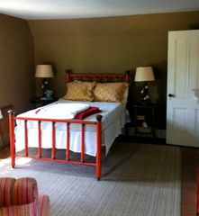 Rhinebeck house photo - Antique tables flank an iron and brass double bed in southwest-facing cocoa room