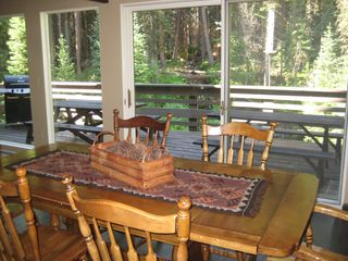 Winter Park house photo - Looking out onto 40 ft deck and stream from dining room