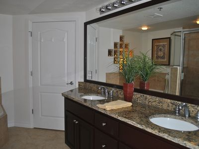 Master bathroom with granite double vanity, jacuzzi tub and separate shower.