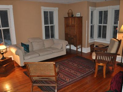 St Paul cabin rental - Living room has ample space for entertaining; board games in big cabinet!