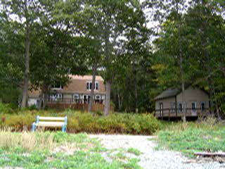 Main house and the additional small 1br cottage as seen from the shore.