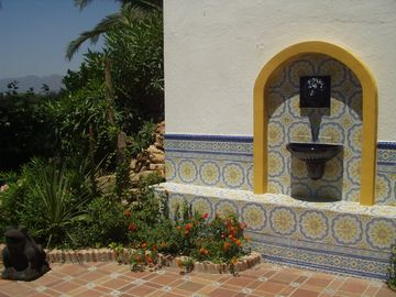 andalusian tiles and fountain in garden