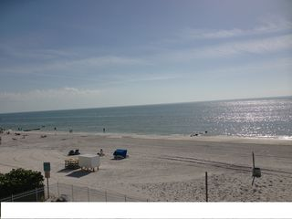 Madeira Beach condo photo - Sunsets, Dolphins, Sand, and Surf...right out your Window/Balcony!
