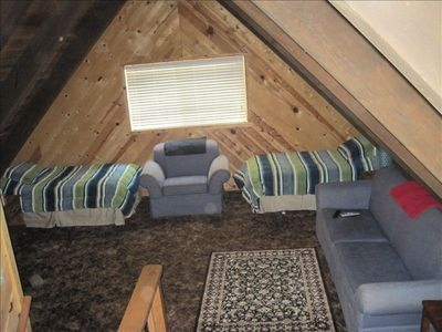 Large loft with two twins and queen pull-out couch. Perfect for the kids!