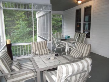 The screened porch,patio set and alfresco dining suite