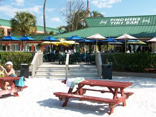 Fort Myers Beach condo photo - Just a short walk down the beach is a Tiki Bar with food & entertainment.