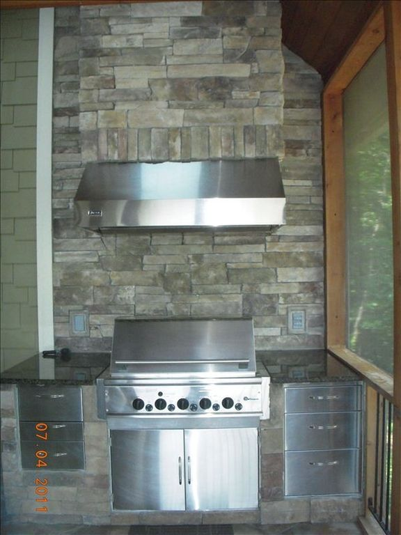 "52"" Monogram stainless steel gas grill with Viking ventilation hood"