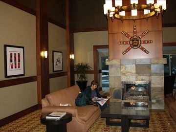Comfortable lobby with fireplace and 24 hour front desk.