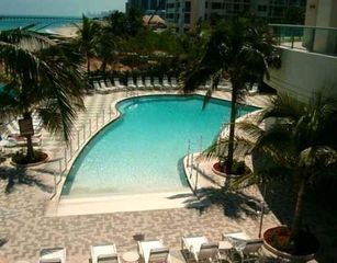 Sunny Isle condo photo - Pool Area next to Ocean