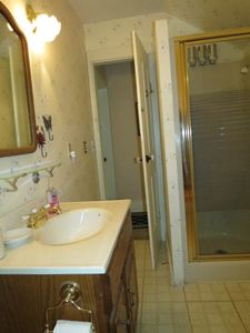 Upstairs Bathroom w/ shower. Accessed from the halls leading to the 2 bedrooms.