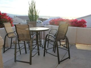 Lake Havasu City house photo - Front Patio with view of lake; table, 6 chairs and umbrella