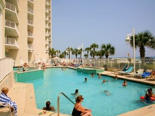 Great outdoor pool with hot tub and waterfalls - Majestic Sun condo vacation rental photo