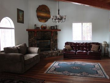 Ironwood Estates house rental - Living Room with fireplace, love seat, pull-out sofa, TV on the opposite wall