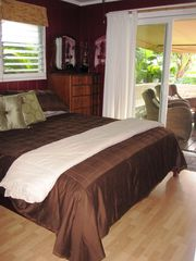 Sunset Beach house photo - California King bed, ceiling fan and silders to lanai area