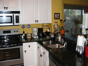 You'll enjoy preparing meals in this quality kitchen, complete with ceiling fan!