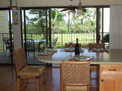 From kitchen looking out at lanai, golf course, ocean.