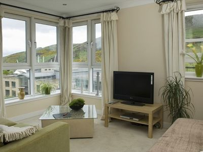 Living room with views out over Holyrood Park and Salibury Crags