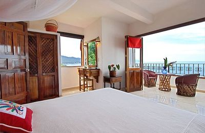Red bedroom with queen bed, spacious balcony, marble bath ensuite + A/C