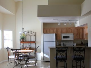 Mesquite condo photo - Sunlit kitchen with table and bar seating