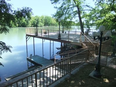 Upper and lower levels of the patio, with boat dock & jet ski dock