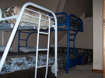 Bunk rm where every bed is a different animal theme. Up above is fun loft area.