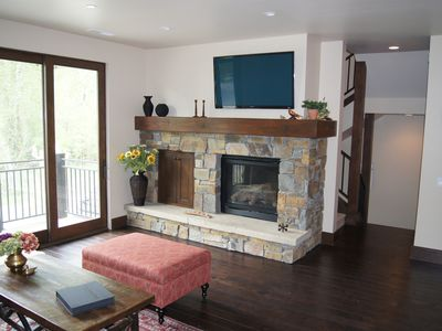 Living room (main floor) - gas fireplace, TV and mountain views.