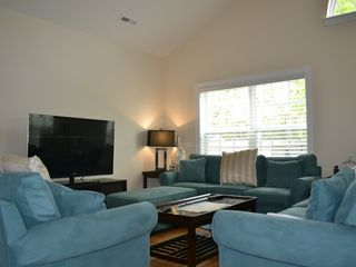 "Private Homes house photo - Living room with 55"" TV, Netflix included, ceiling fan, queen size sleeper"