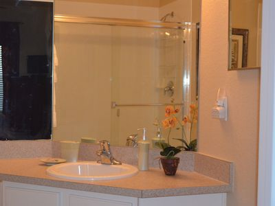 Private master bath with shower. Fluffy luxury bath linens and hairdryer.