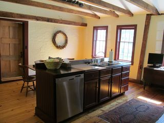 Woodstock house photo - Another view of kitchen, small DVD player, seating at antique trestle table