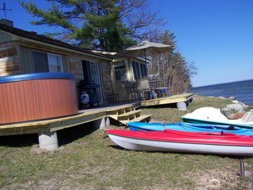 Shoreline..Kayaks and Paddleboat to use while you stay on your own private beach