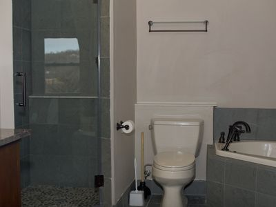A large master bathroom with a stand alone shower