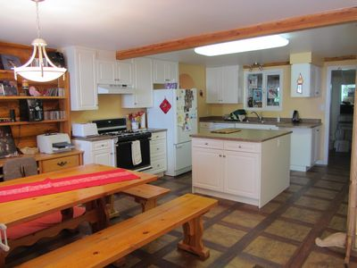Silver Star Mountain chalet rental - Kitchen with eating area; laundry room