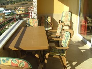 Alanya apartment photo - Big terrace side of livingroom and kitchen, view on big pool and mountain