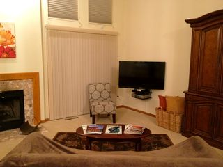 Spacious relaxing living room w/ large HDTV & HD signal and high-speed internet - Lake Geneva cottage vacation rental photo